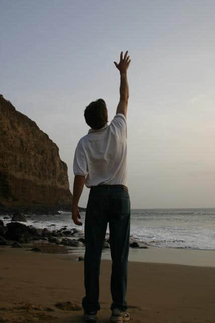 Man Reaching to Sky